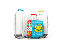 Luggage with flag of saint pierre and miquelon. Three bags isola. Ted on white. 3D illustration Royalty Free Stock Photo