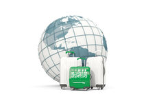 Luggage with flag of saudi arabia. Three bags in front of globe. 3D illustration Royalty Free Stock Photography