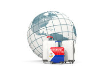 Luggage with flag of sint maarten. Three bags in front of globe Stock Image