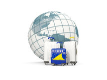 Luggage with flag of tokelau. Three bags in front of globe Stock Image