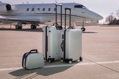 Luggage in front of a corporate jet airplane Royalty Free Stock Photos