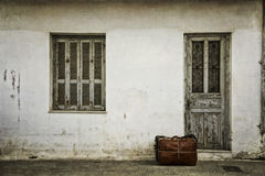 Luggage in front of a door Royalty Free Stock Photos