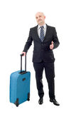 Luggage. Full length of young businessman with luggage isolated on white background Royalty Free Stock Photos