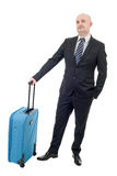 Luggage. Full length of young businessman with luggage isolated on white background Royalty Free Stock Photo