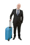 Luggage. Full length of young businessman with luggage isolated on white background Stock Images