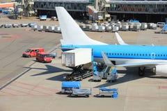 Luggage handling at airport Stock Image