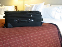 Luggage in hotel room. Luggage on the bed of a hotel room Royalty Free Stock Image
