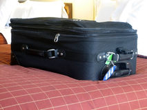 Luggage in hotel room. Luggage in the beds of a hotel room Royalty Free Stock Photos