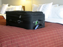 Luggage in hotel room. Luggage in the beds of a hotel room Royalty Free Stock Photography