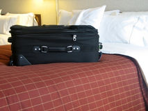 Luggage in hotel room. Luggage in the beds of a hotel room Stock Photos