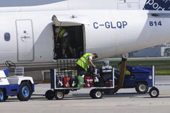 Luggage loading in a plane Stock Photos
