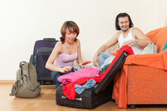 With luggage looking clothes for a great holiday. Couple with luggage looking clothes for a great holiday Royalty Free Stock Photography