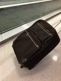 Luggage next to moving sidewalk. Royalty Free Stock Images