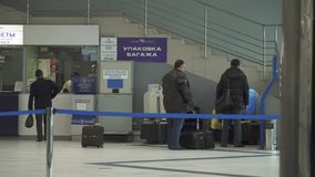 Luggage packing at the International Novosibirsk Tolmachevo Airport stock footage video stock video footage