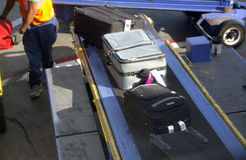 Suitcase packing at airport  Stock Images