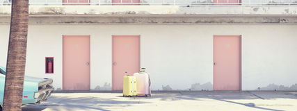Luggage beside parked car outside motel. 3d rendering Royalty Free Stock Photos