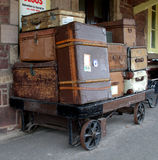 Luggage on a Railway Platform. Nostalgic view of old Luggage and Baggage on a Platform Trolley at a Train Station in England Royalty Free Stock Photos
