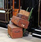 Luggage on a Railway Platform. Nostalgic view of old Luggage and Baggage on a Platform Trolley at a Train Station in England Royalty Free Stock Images