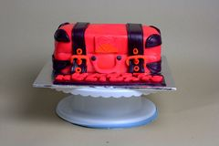 Luggage shaped fondant cake red and black Royalty Free Stock Images