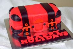 Luggage shaped fondant cake red and black Royalty Free Stock Photos