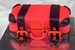 Luggage shaped fondant cake red and black Royalty Free Stock Photography