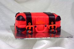 Luggage shaped fondant cake red and black. Luggage shaped fondant cake with red and black color. Bon Voyage theme, farewell cake royalty free stock photo