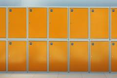 Luggage storage. Rows of orange box luggage storage, nobody Royalty Free Stock Photos