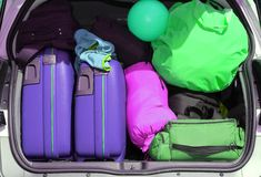 Luggage and suitcases in car. Car and plenty of luggage and suitcases when leaving for family summer holidays Royalty Free Stock Photos