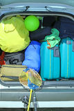 Luggage and suitcases in car. Suitcases and luggage in the trunk while traveling in family Stock Image