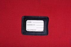 Luggage tag. Black leather Luggage tag name,address,telephone Stock Photo