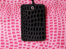 Luggage tag. Black luggage tag on textured pink bag Stock Photography