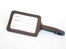 Luggage tag. Isolated black leather luggage tag with address space Royalty Free Stock Image