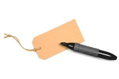Luggage tag and marker pen Stock Photography