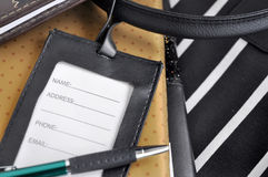 Luggage tag with pen put on organizer book Stock Image