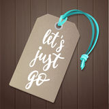 Luggage tag with travel inspiration quote. Stock Image