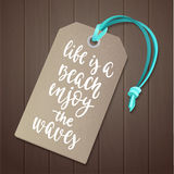 Luggage tag with travel inspiration quote. Stock Images