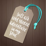 Luggage tag with travel inspiration quote. Royalty Free Stock Photo