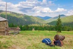 Luggage, tourists. Knapsacks bags on  background of the forest landscape. Carpathians. Royalty Free Stock Image