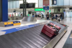 Luggage on the track blur background in airport Stock Photos