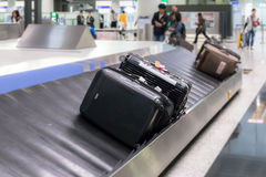 Luggage on the track blur background in airport. Luggage on the track blur background and selective object in airport Royalty Free Stock Photos
