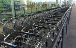 Luggage transportation carts Stock Images