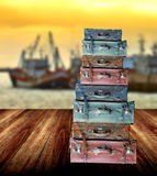 Luggage for travel on wooden floor. Beside the jetty Royalty Free Stock Photo