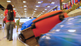 Luggage travels on a conveyor belt in the airport Royalty Free Stock Photography