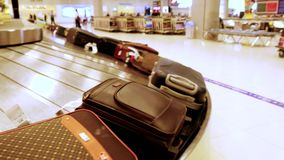 Luggage travels on a conveyor belt in the airport. 3840x2160, 4k. Luggage travels on a conveyor belt at the airport stock footage