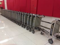 Luggage trolley queue. Passenger luggage trollies at LAX airport waiting for passengers to pay for their use Royalty Free Stock Images