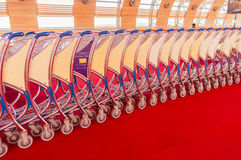 Luggage trolley stacked together at the airport Stock Images