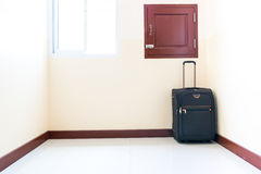 Luggage trolley was placed in the corner of the room. Stock Photo