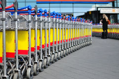 Luggage trolleys in a row Royalty Free Stock Images