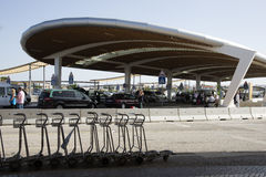 Luggage trollies at airport drop off area. Airport drop off and collect area with luggage trollies Stock Image