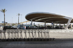 Luggage trollies at airport drop off area. Airport drop off and collect area at Faro Portugal Royalty Free Stock Photo